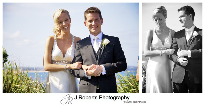 Bride and groom with collaroy beach behind - wedding photography sydney