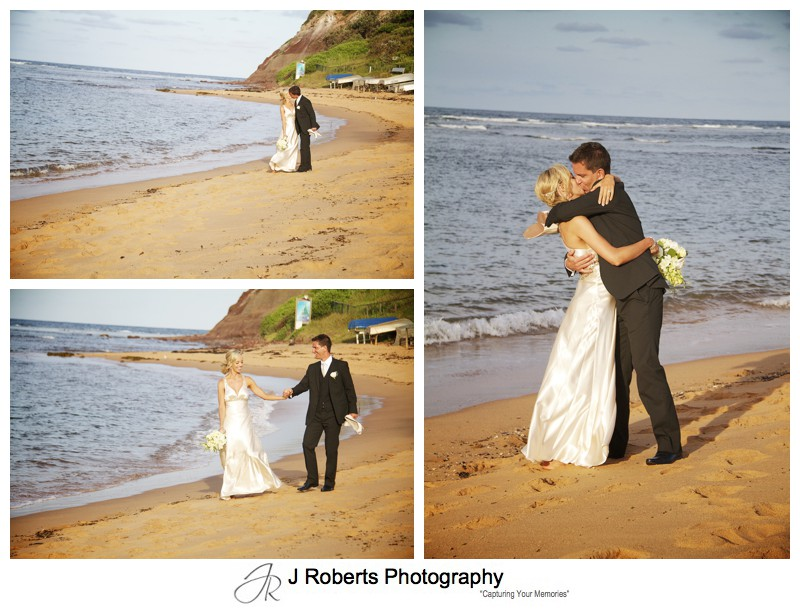 Bride and groom walking along Long Reef Beach in setting sun - wedding photography sydney