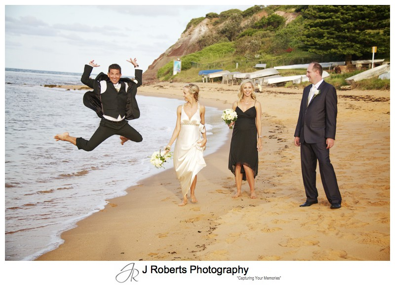 Groom jumping with bridal party laughing - wedding photography sydney