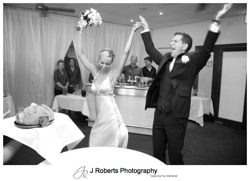 Bride and groom party in to announcement at reception - wedding photography sydney