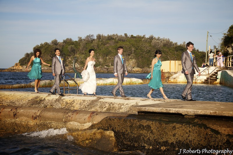Bridal party walking in line at sunset - wedding photography