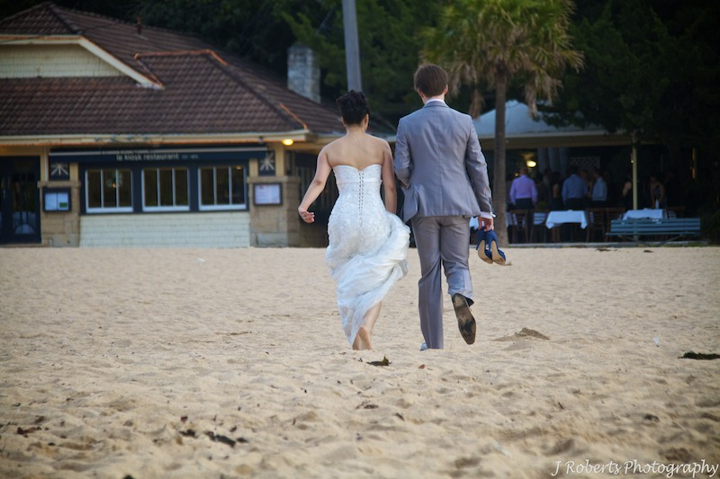 Couple walking on beach - wedding photography