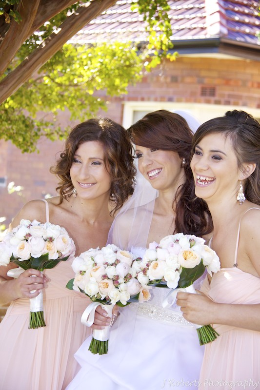 Bride and bridesmaids laughing - wedding photography sydney