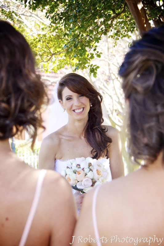 Bride smiling at her bridesmaids - wedding photography sydney