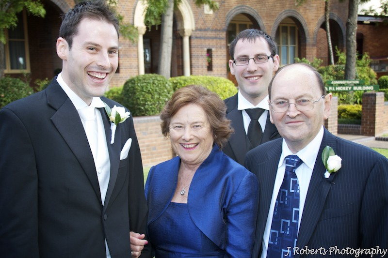 Groom laughing with his family - wedding photography sydney