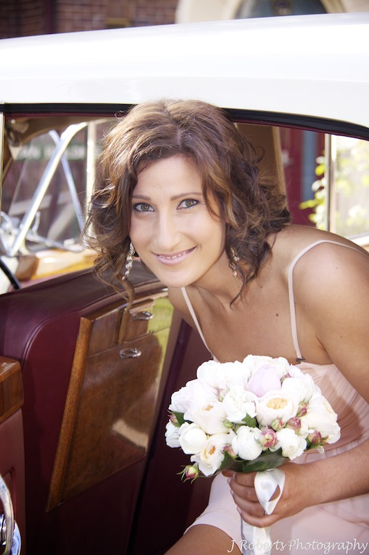 Brides sister a bridesmaid getting out of the cars at the church - wedding photography sydney