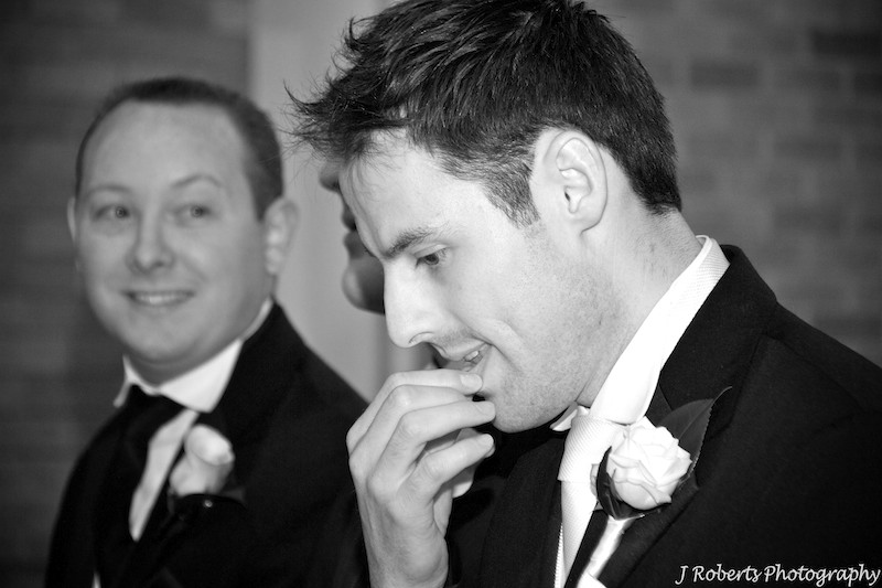 Groom nervously waiting in the church - wedding photography sydney