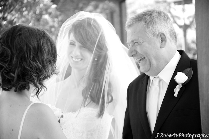 Bride laughing with her father outside the church - wedding photography sydney