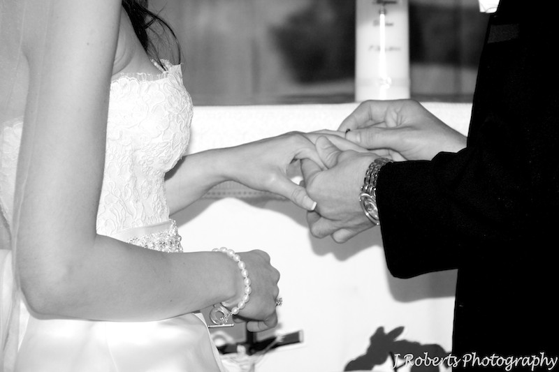 Exchanging rings during the marriage ceremony - wedding photography sydney