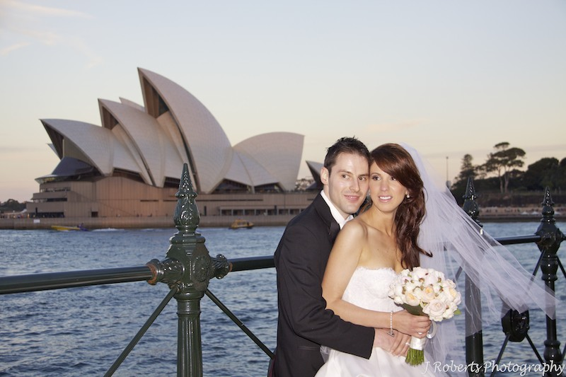 Bride and groom at sunset with Sydney Opera House - wedding photography sydney