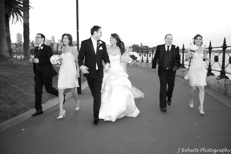 B&W Bridal party running together - wedding photography sydney