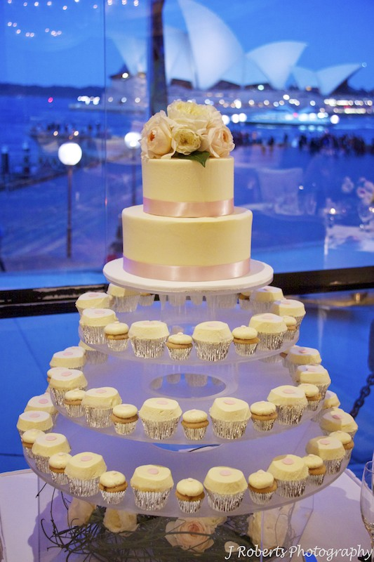 Wedding cake in front of window and Sydney Opera House Wolfies Grill The Rocks - Wedding photography sydney