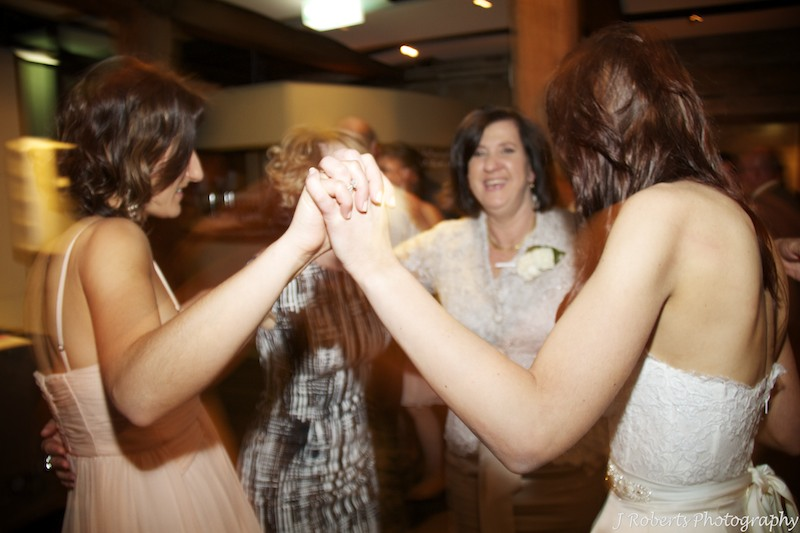 Bride dancing with her family - wedding photography sydney