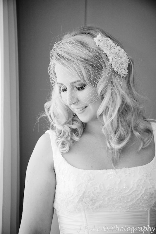 B&W of bride with fishnet veil - wedding photography sydney