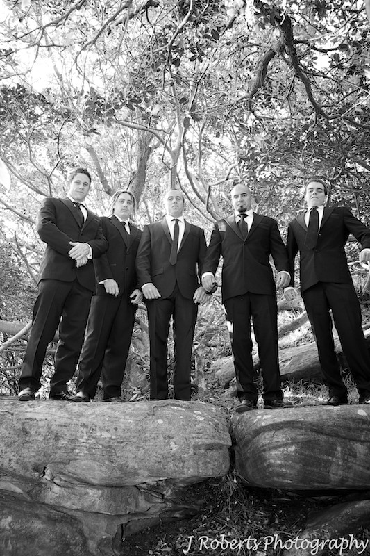 Groomsmen puffing their chests out - wedding photography sydney