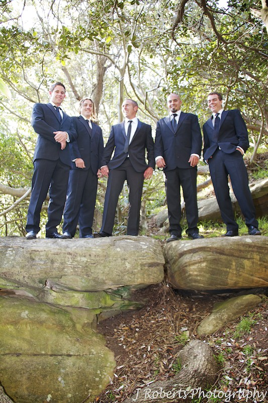 Groom laughing with groomsmen - wedding photography sydney