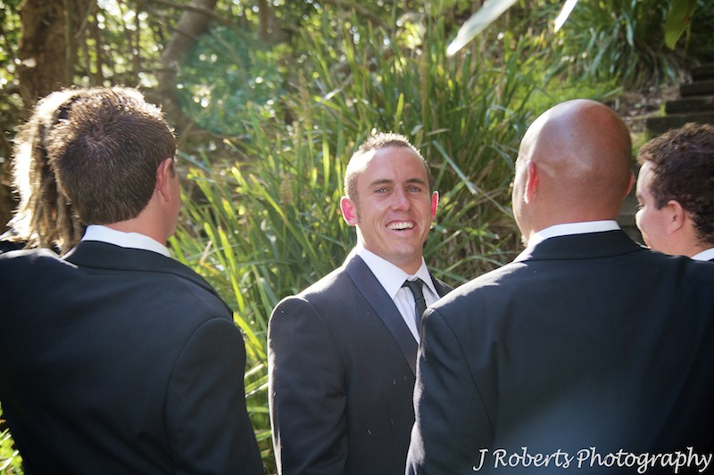 Groom laughing back at the camera - wedding photography sydney