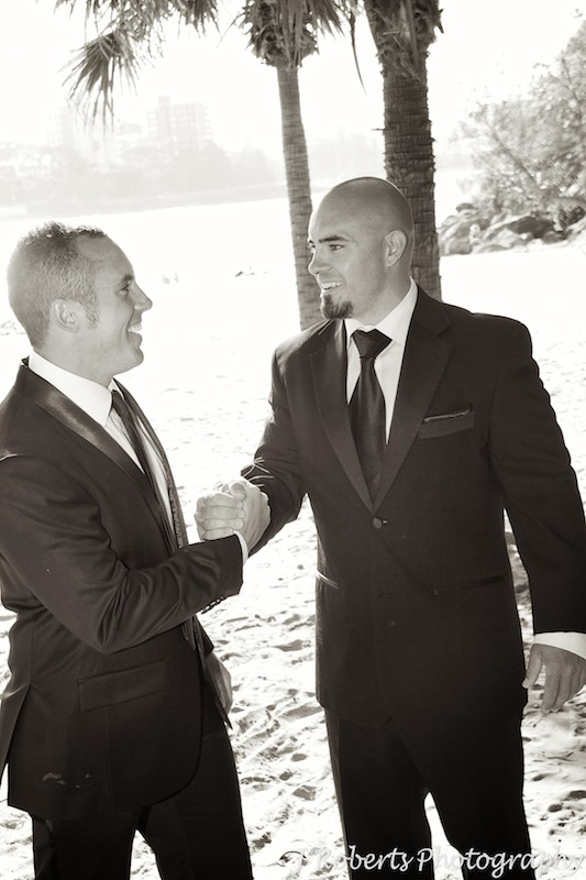 Groom shaking hand with groomsman - wedding photography sydney