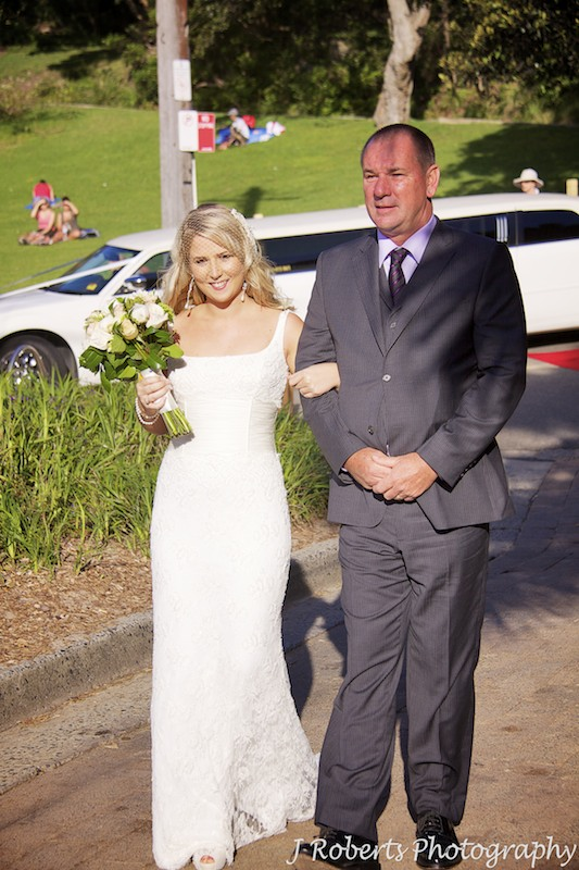 Bride arriving for ceremony at Shelley Beach - wedding photography sydney