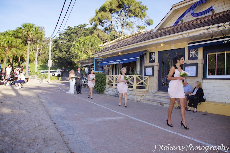 Bride walking to wedding ceremony in front of Le Kiosk Shelley Beach - wedding photography sydney