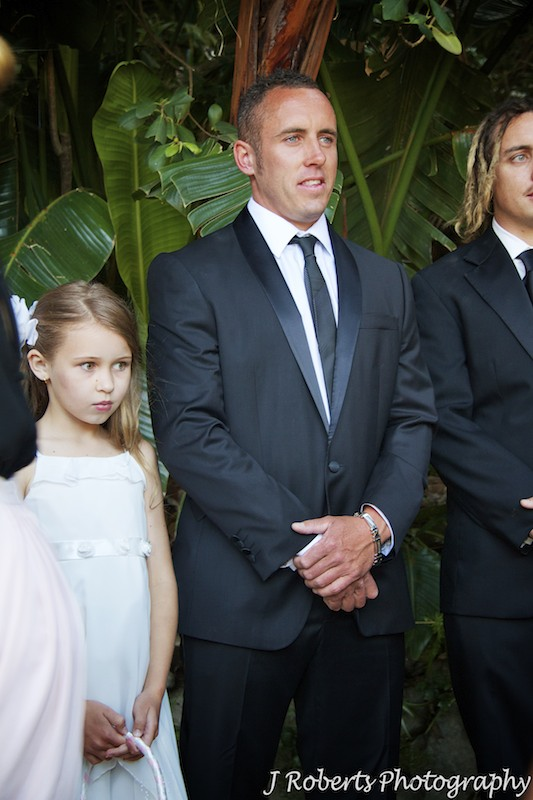 Groom with his daughter a flower girl waiting for bride - wedding photography sydney