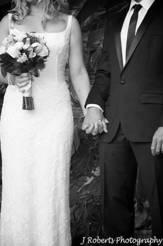 Bride and groom holding hands during wedding ceremony - wedding photography sydney