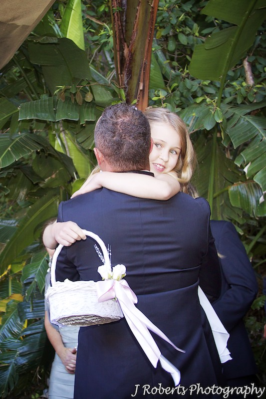 Daughter hugging groom after wedding ceremony - wedding photography sydney