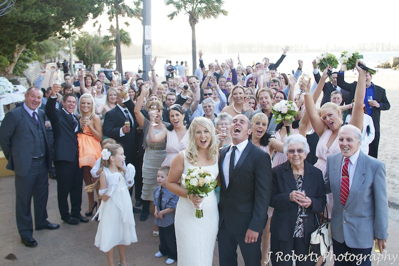 All guests cheer for couple - wedding photography sydney