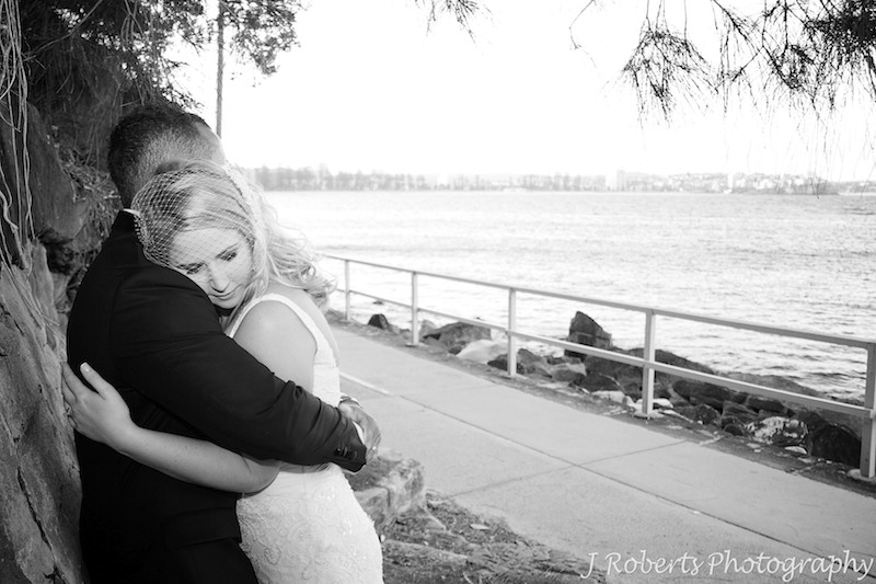 Groom hugging bride - wedding photography sydney