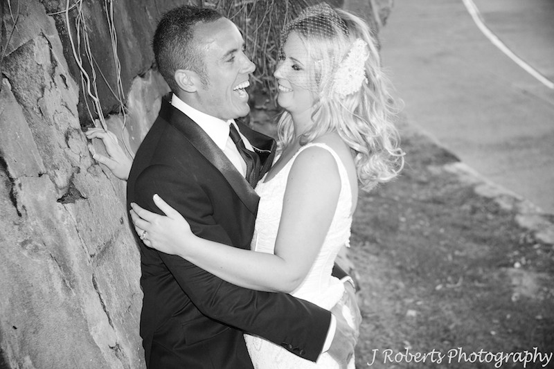 Groom laughing while he grabs brides bottom - wedding photography sydney