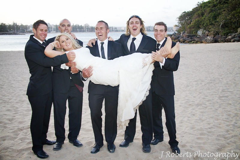 Groomsmen holding the bride up - wedding photography sydney