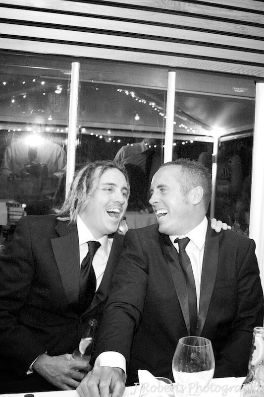 Laughing groom and best man during wedding speeches - wedding photography sydney