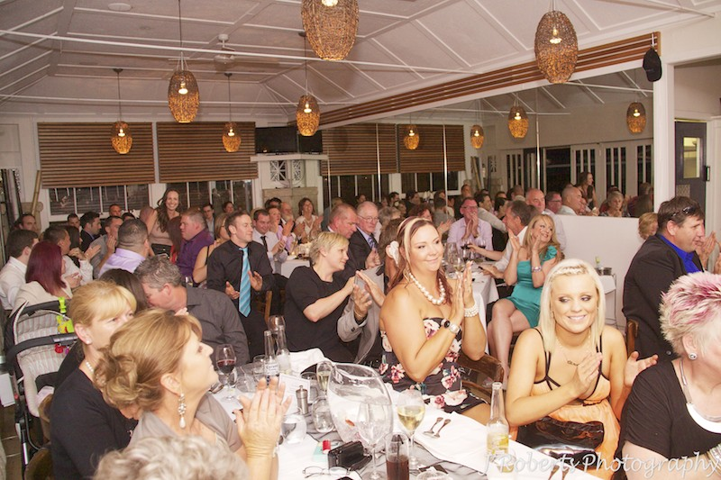 Guests clapping during wedding speeches - wedding photography sydney