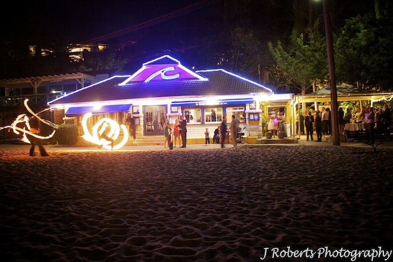 Fire throwers outside Le Kiosk Shelley Beach wedding reception - wedding photography sydney