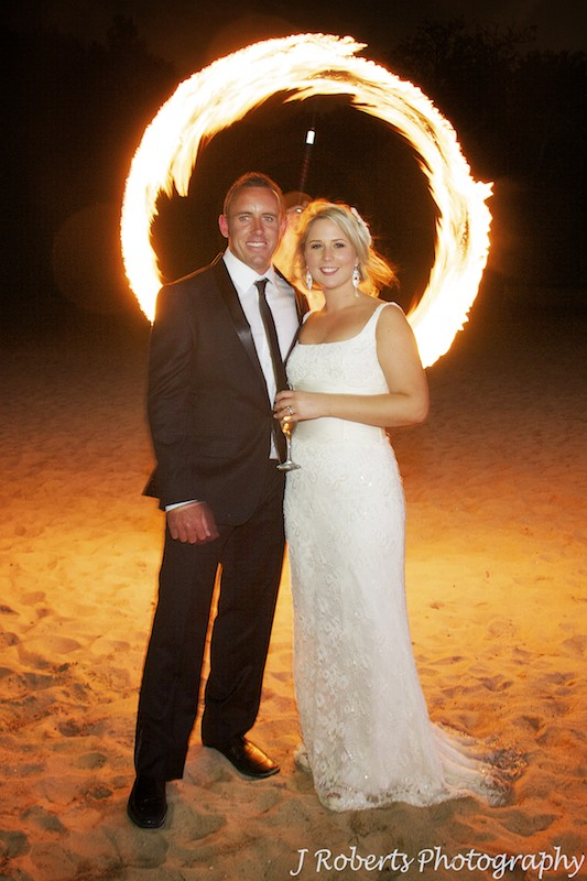 Bride and groom in ring of fire dancing fire - wedding photography sydney