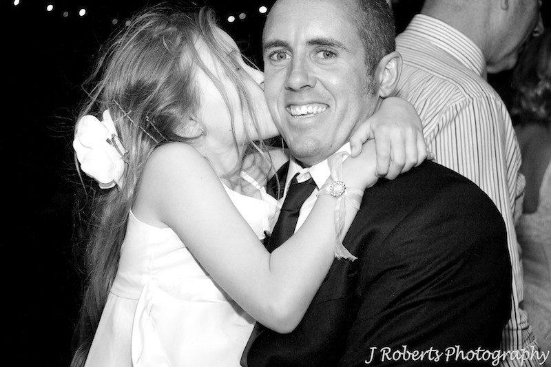 groom being kissed by his young daughter at end of wedding - wedding photography sydney