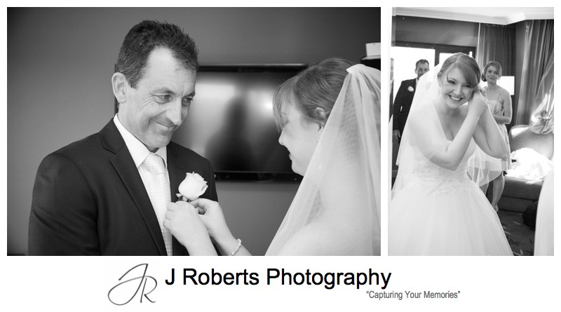 Bride putting button hole on father - wedding photography sydney
