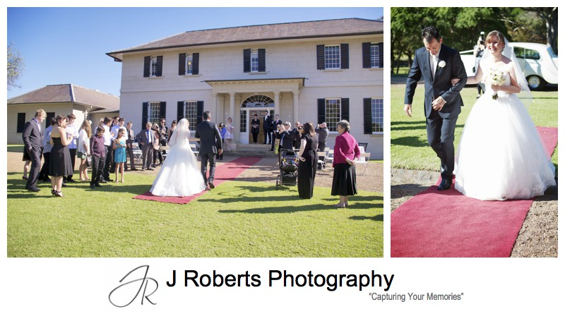 Bride walking down the red carpet on the lawns of Old Government House Parramatta - wedding photography sydney