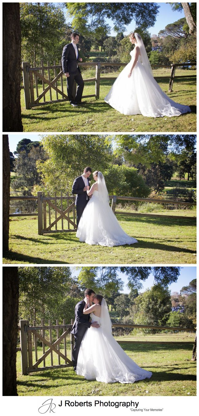 Bride and groom with rustic fence at Old Government House Parramatta - wedding photography sydney