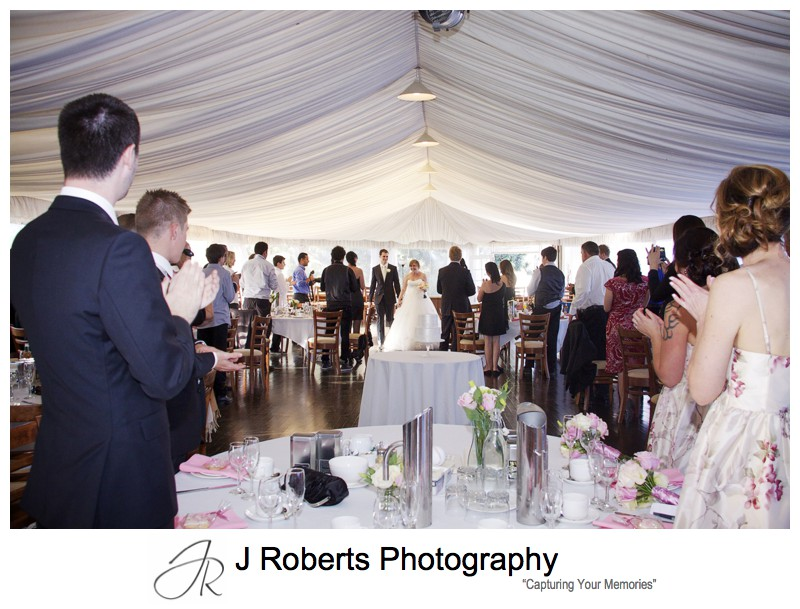Bride and grooms arrival at high tea reception in the marquee at old government house parramatta - wedding photography sydney