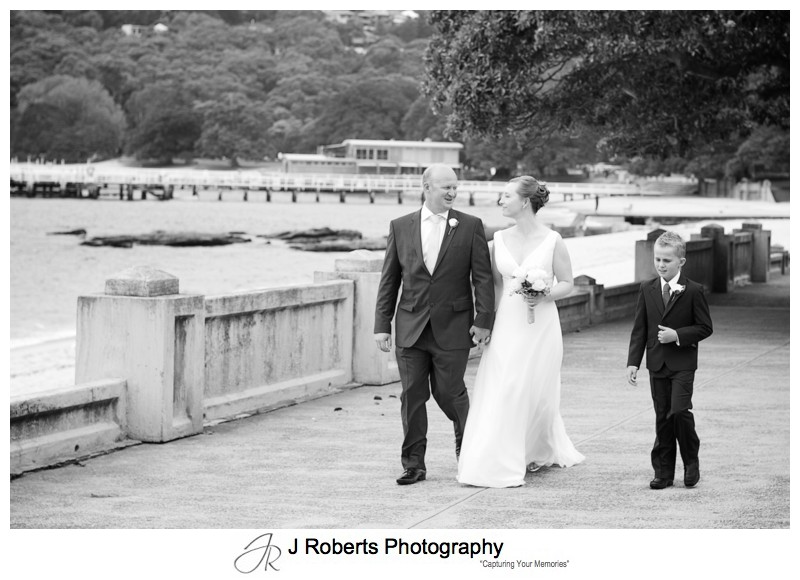 Couple and son walking along the Esplanade Balmoral - wedding photography sydney