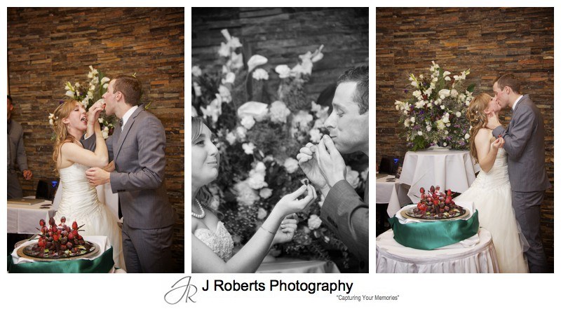 Bride and groom sharing strawberry tower wedding cake - wedding photography sydney