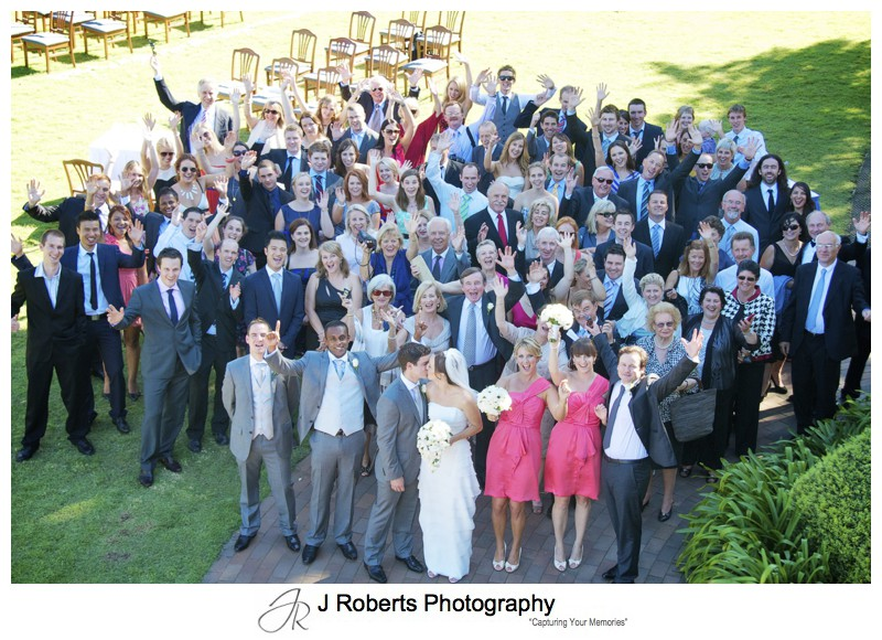 All the guests cheering at the wedding - wedding photography sydney