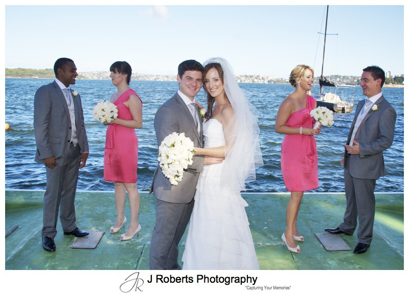 Bridal party on the pontoon at RSYS - wedding photography sydney
