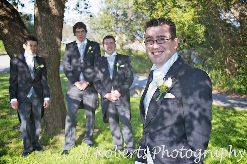 Groom and his grooms men laughing - wedding photography sydney