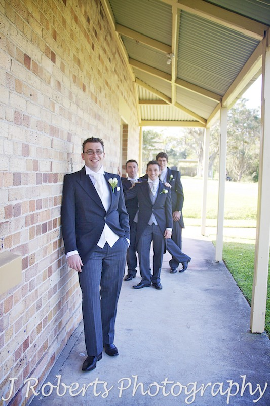 Groom leaning on historical buildings at Georges Head Mosman - wedding photography sydney