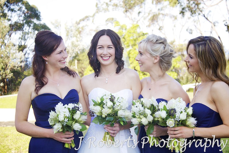 Bride and her bridesmaids smiling pre wedding - wedding photography sydney