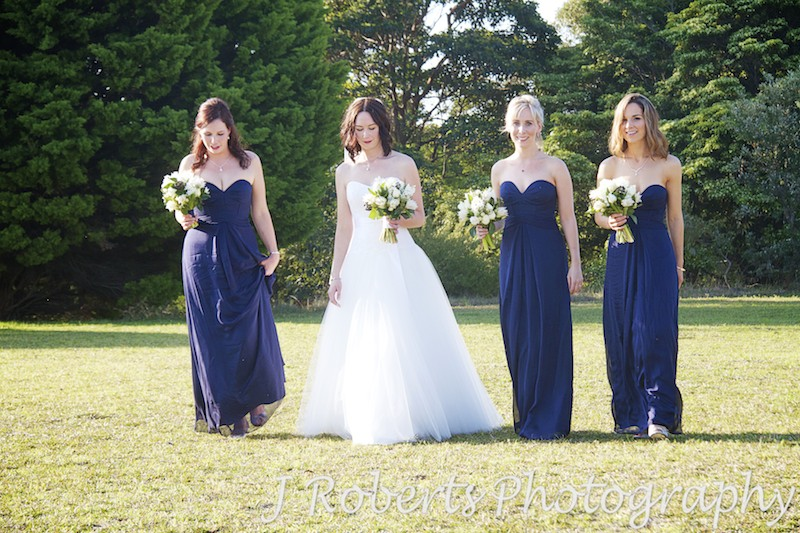 Bride walking in afternoon sun with bridesmaids at Georges Heights Mosman - wedding photography sydney