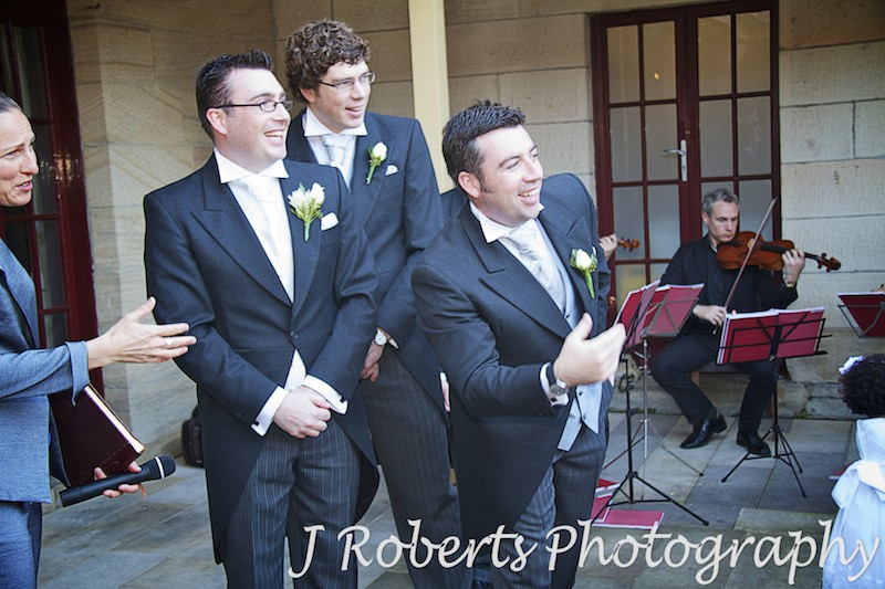 Groomsmen encouraging paige boys down the aisle - wedding photography sydney