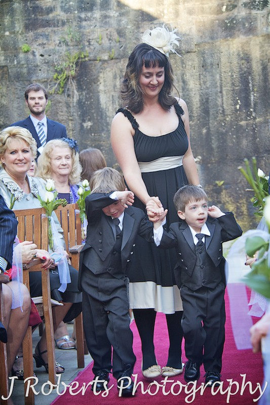 Paige boys walking down the aisle holding Mum's hand - wedding photography sydney